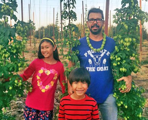 Redwood Hill Farm Manager Scott Bice with children Nicole and Colton in the hops yard.