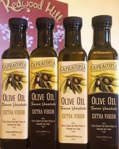 four bottles of our extra virgin olive oil