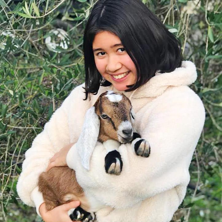 Nicole Bice cuddling a baby goat